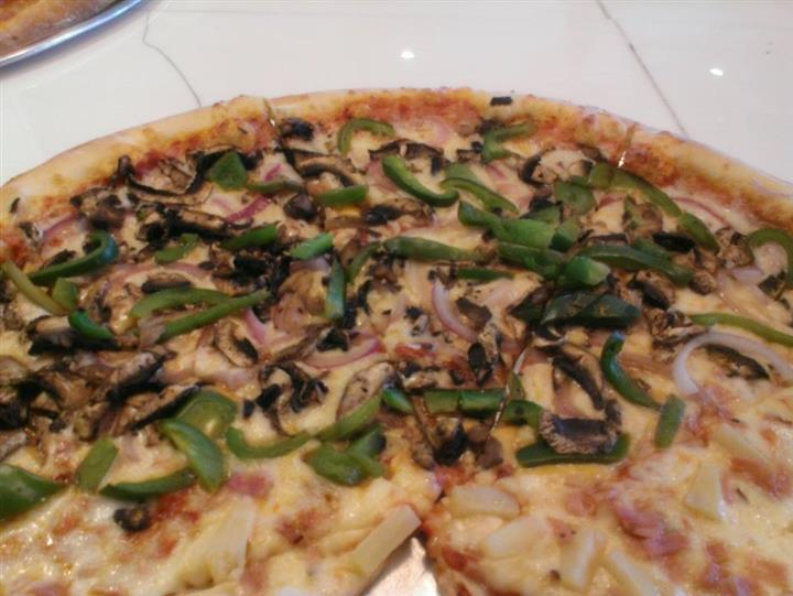 Pizza with green pepperse, mushrooms, onions