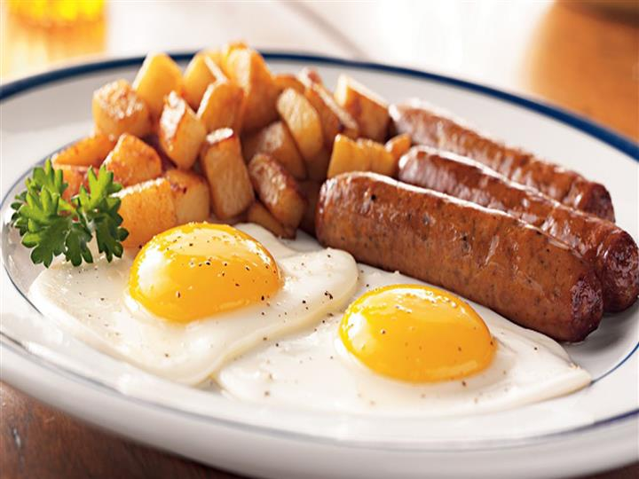 2 fried eggs served with 3 links of sausage and home fries