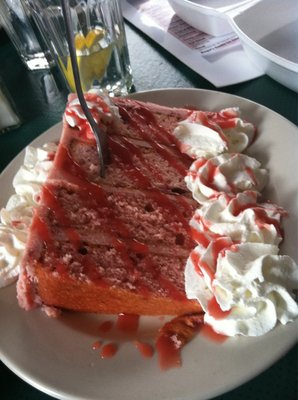 cake with whipped cream and syrup