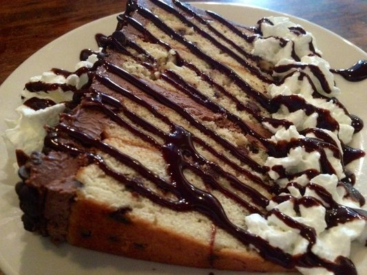Cake slice with chocolate syrup