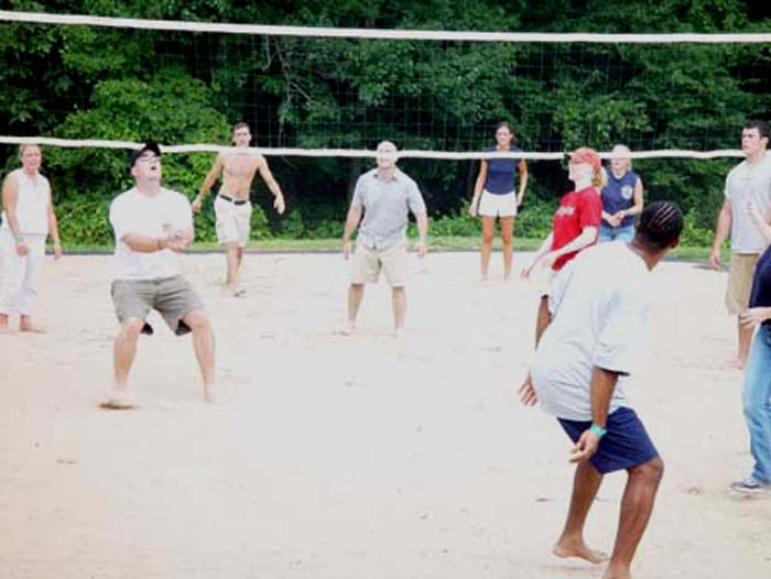 a group playing sand volleyball