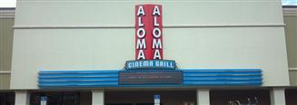 outside of aloma cinema grill during the day