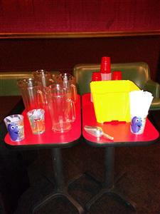 tray of empty cups and empty beer pitchers