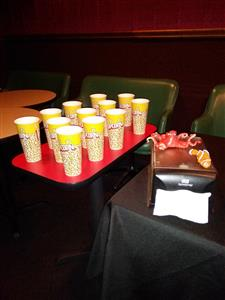 tray of tall cups for popcorn