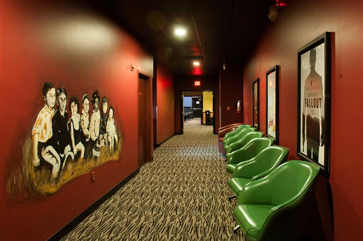 outside of movie theater with a row of chairs