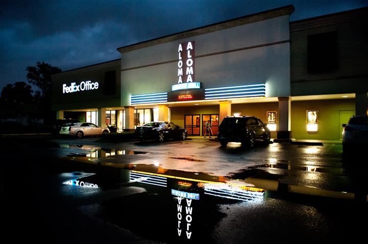 parking lot of aloma cinema grill at night