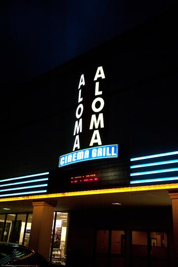 outside of aloma cinema grill at night