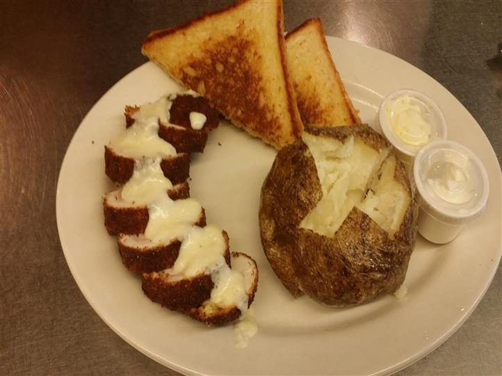 Toast and a baked potato with a side of butter
