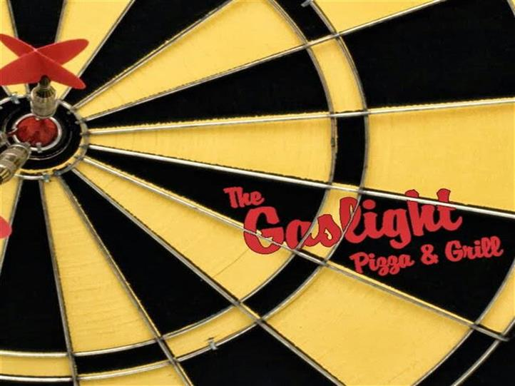 Dartboard with Gaslight logo on it