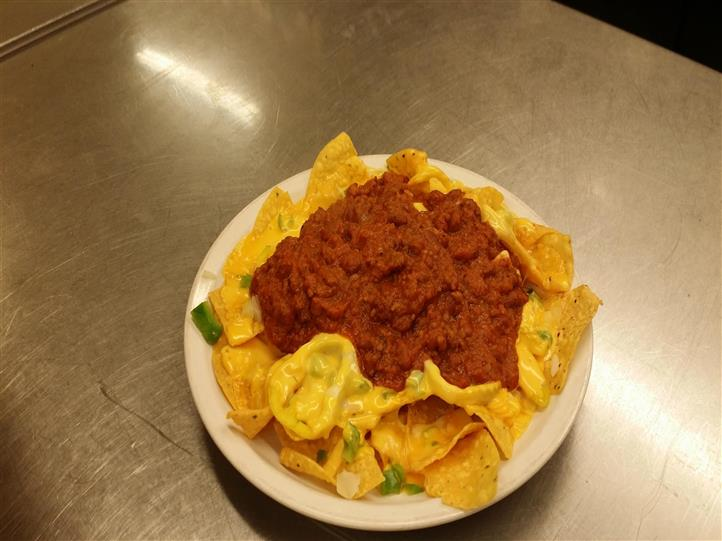 Nacho platter with ground beef in the center