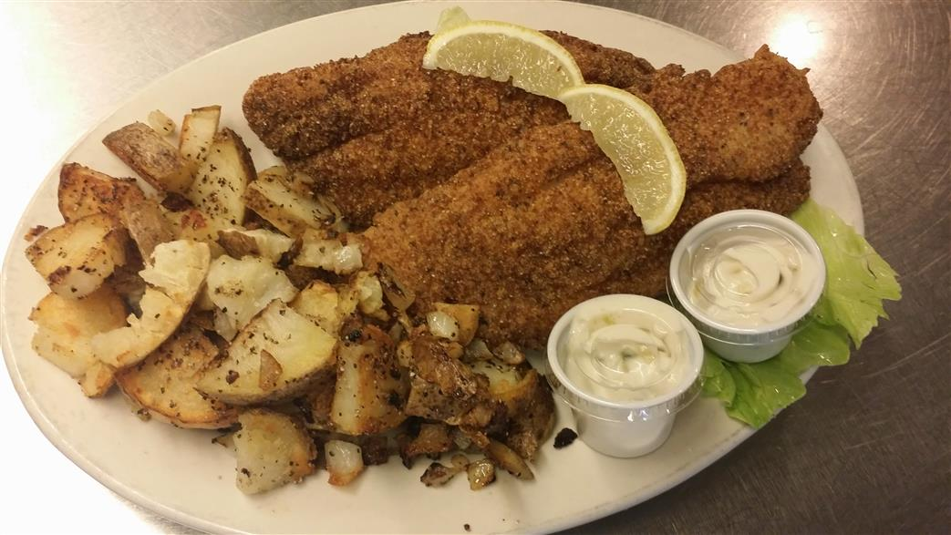 Fried fish with a side of potatoes