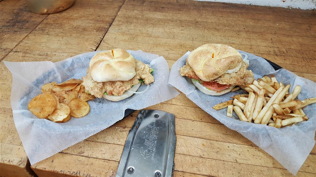Chicken Sandwiches with sides of potatoes and french fries