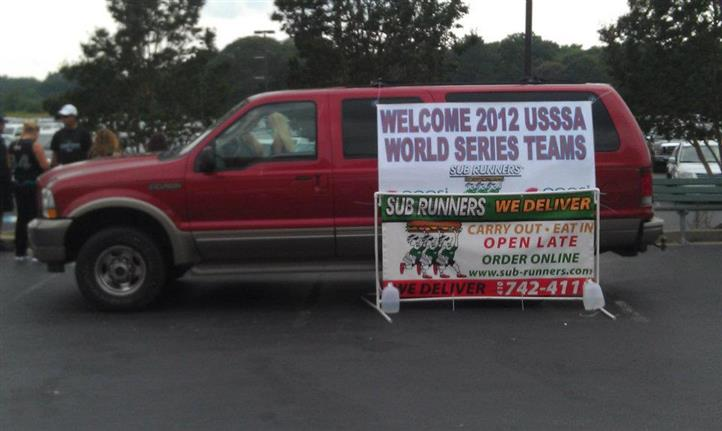 """truck with sign """"Welcome 2012 USSSA World Series Teams"""""""