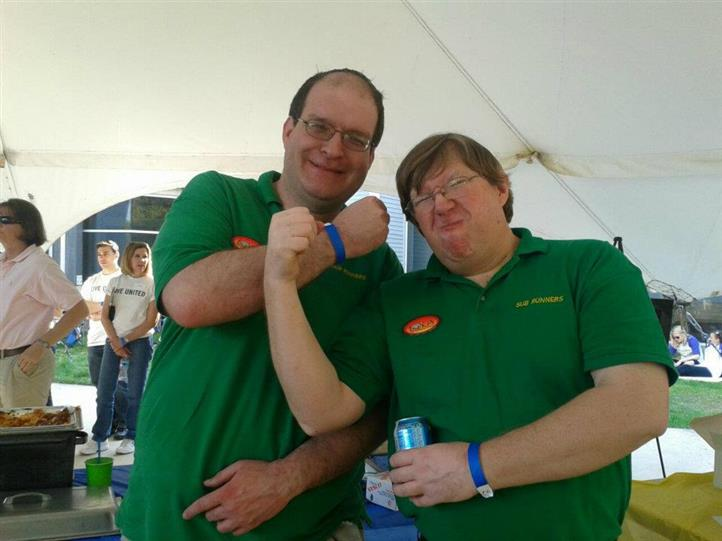 two people smiling and making faces