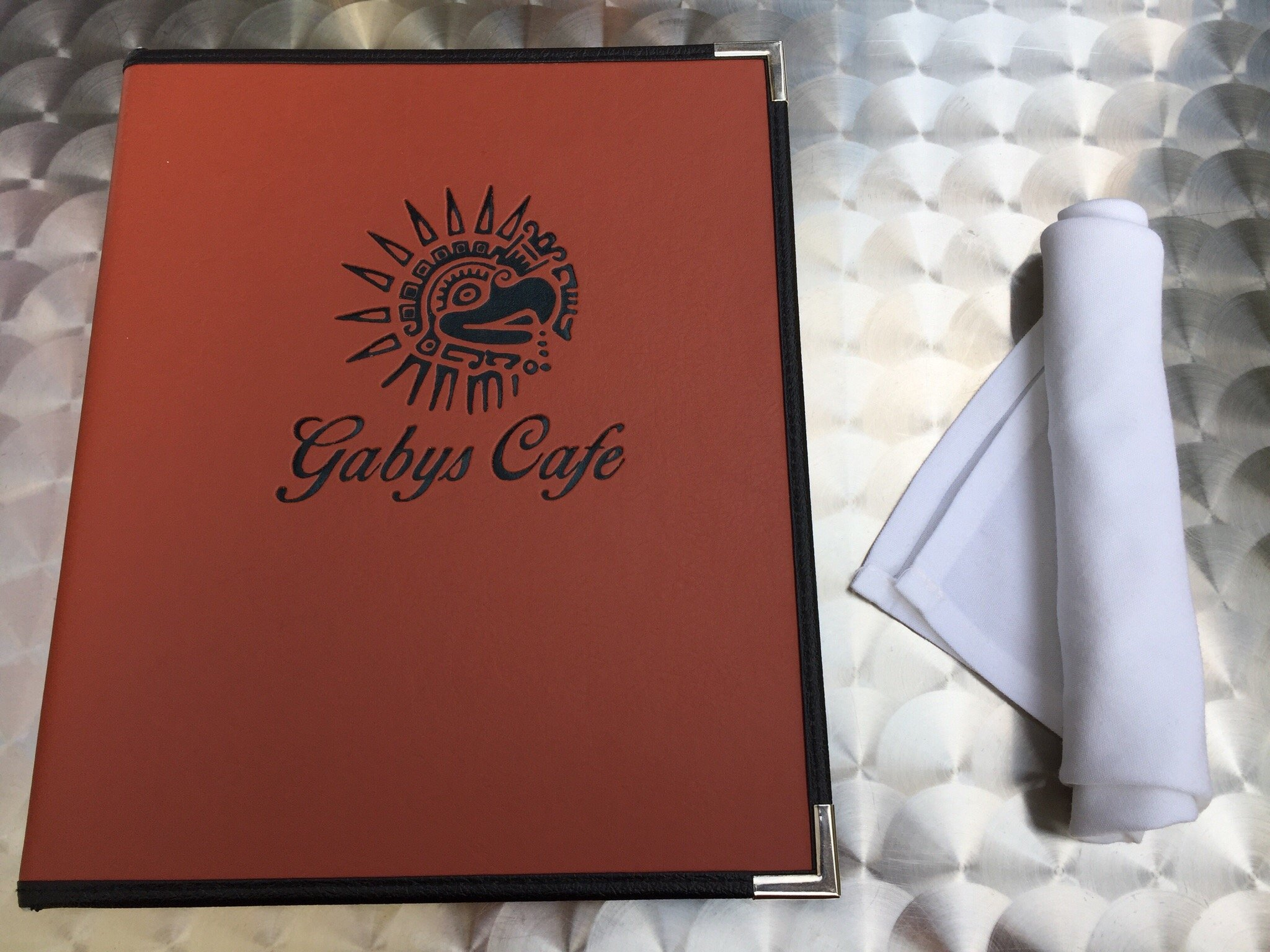 gabys cafe menu displayed on a table