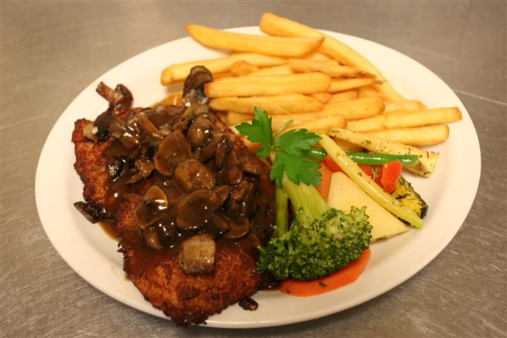 country fried steak with fries and vegetables