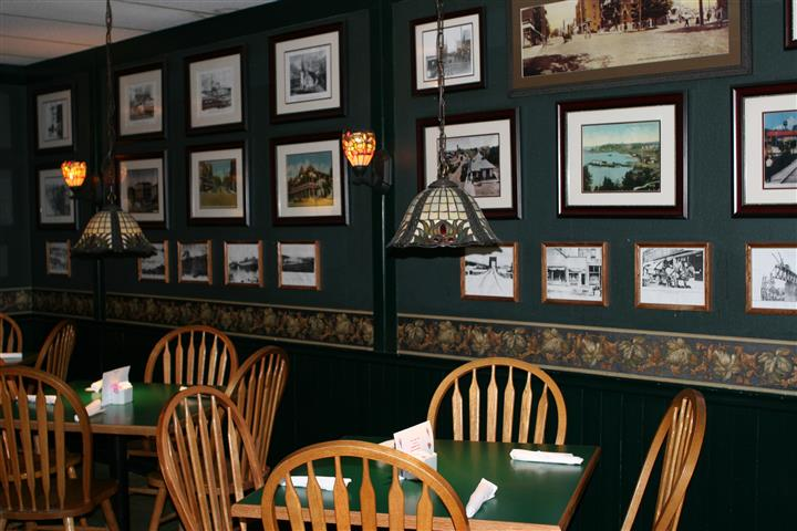 interior dining area with picture frames decorated throughout the wall