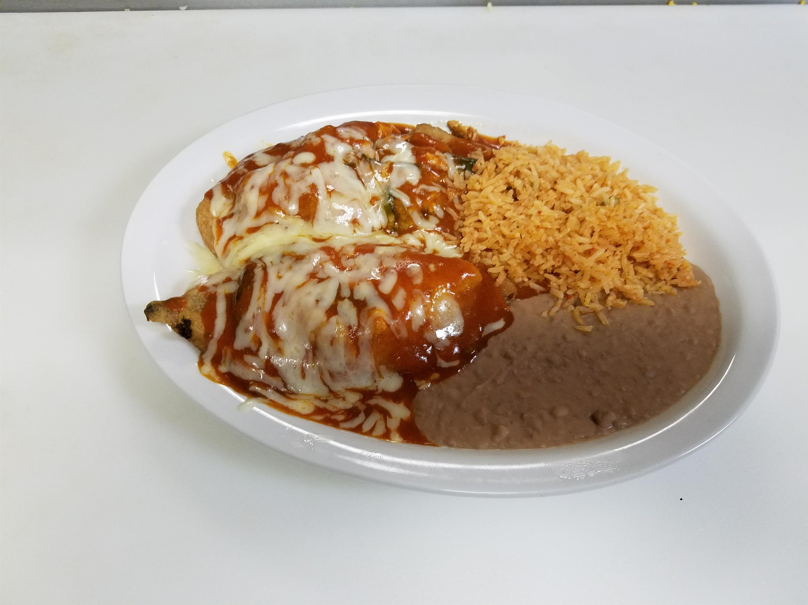 refried beans, rice, and chicken with cheese and sauce on top