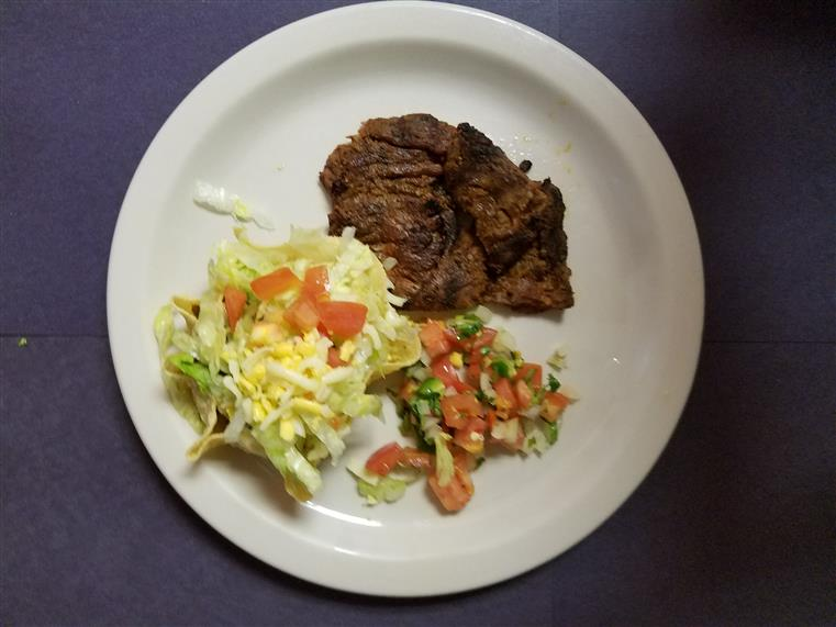 grilled steak with a side salad