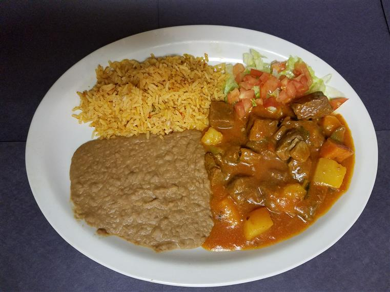 beef hunks with potatoes, refried beans, and rice