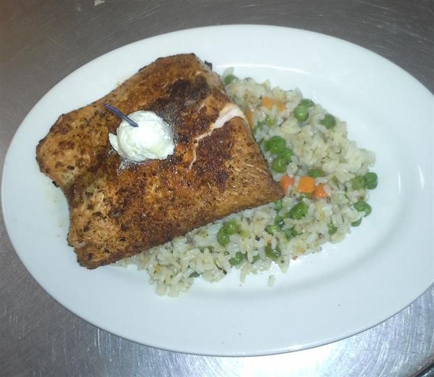 Crusted fish served over rice