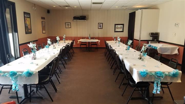 Long tables with black table cloths and blue decoration
