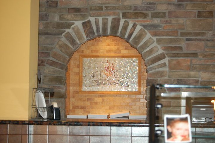 Panting in decorative brick oven
