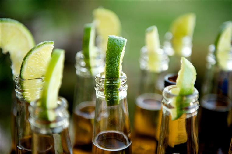 Beer bottles with limes inserted in openings