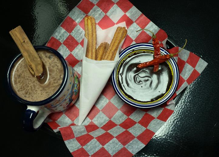 churros with a side of hot chocloate