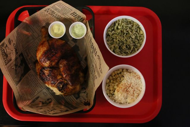 roasted chicken in a bowl with various sides