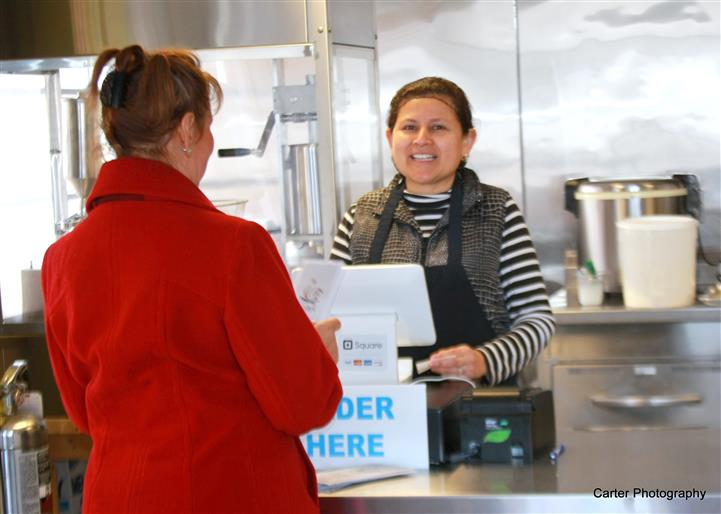 an employee taking an order at the register