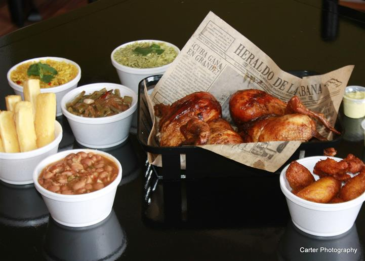 roasted chicken in a bowl with various side dishes