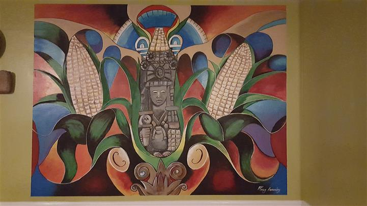 a mural depciting aztec ruins, and corn
