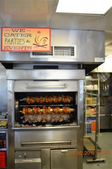 rotisserie with chicken in it