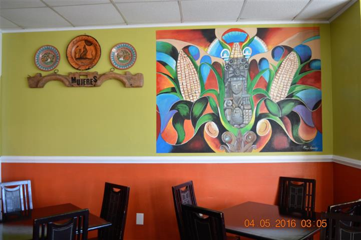 dining room area with mural