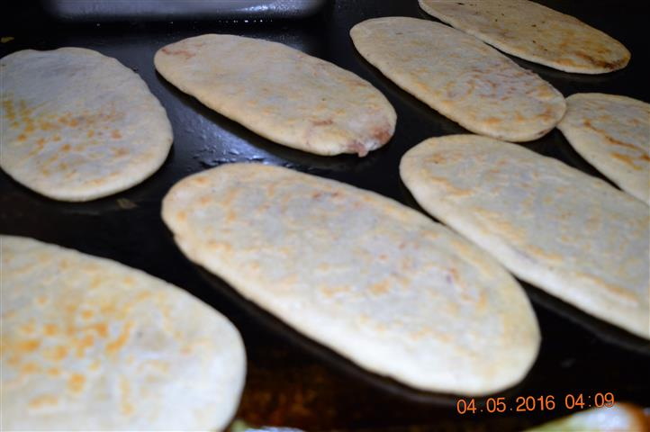 several tortillas on a grill