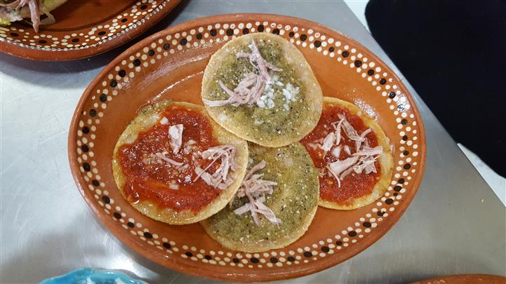plate of tortillas with sauce