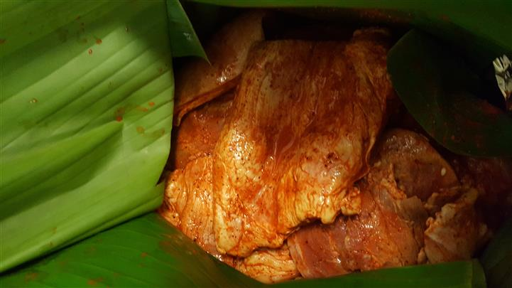 marinated raw chicken wrapped in banana leaves