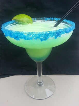 large margarita with a straw and lime wedge