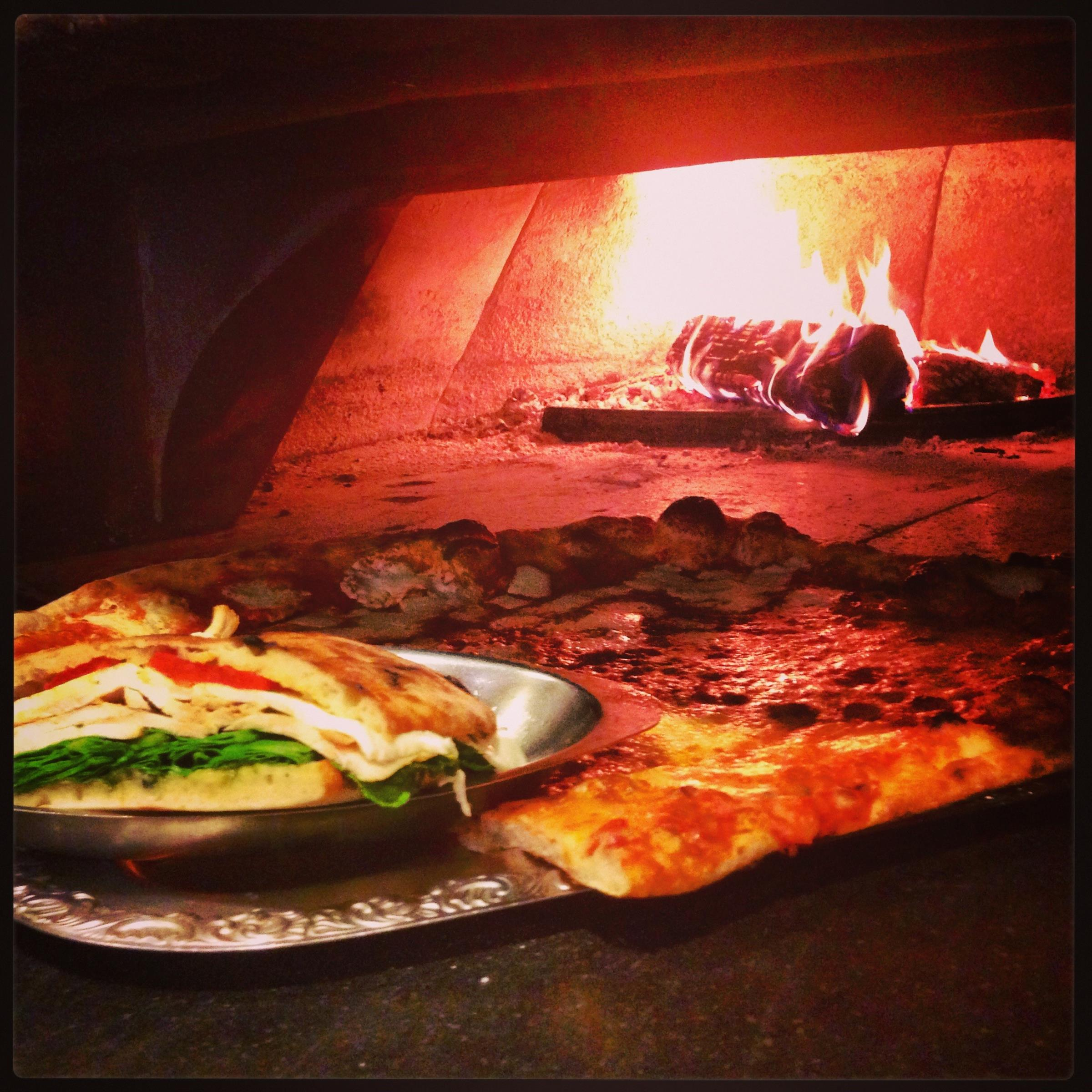 Food going into a wood fire oven