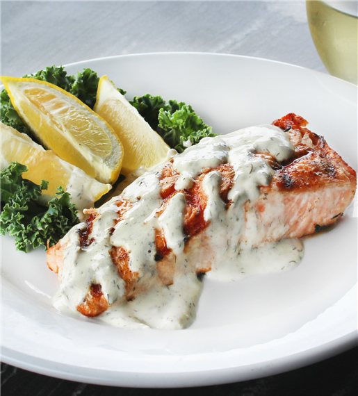 GRILLED ATLANTIC SALMON. Atlantic salmon topped with dill aioli. Served with choice of soup or salad and one side.