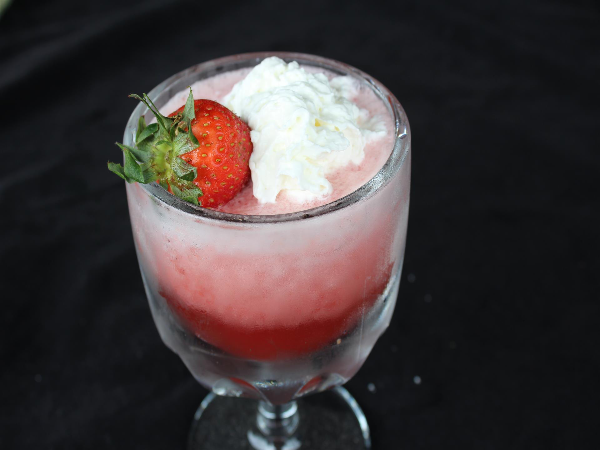 strawberry daiquiri topped with whipped cream