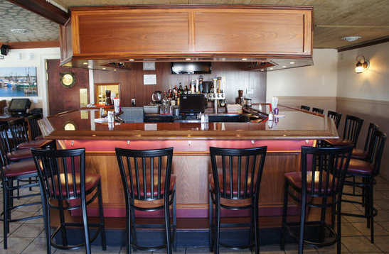 bar area with large counters and chairs