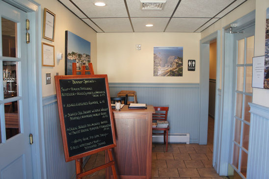 front entrance to the seahorse restaurant with a chalkboard written with the daily specials