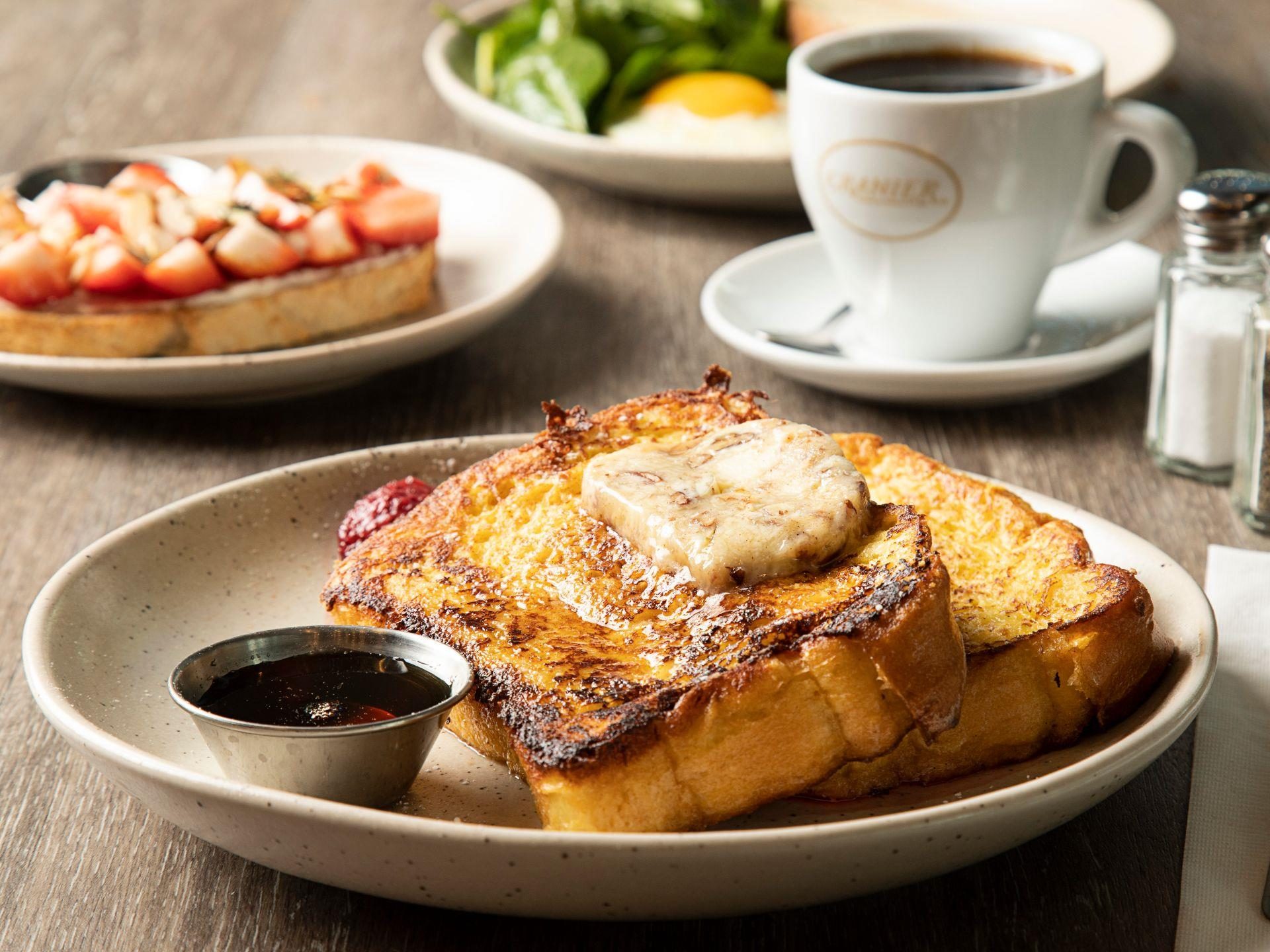 French toast on a plate with butter and maple syrup