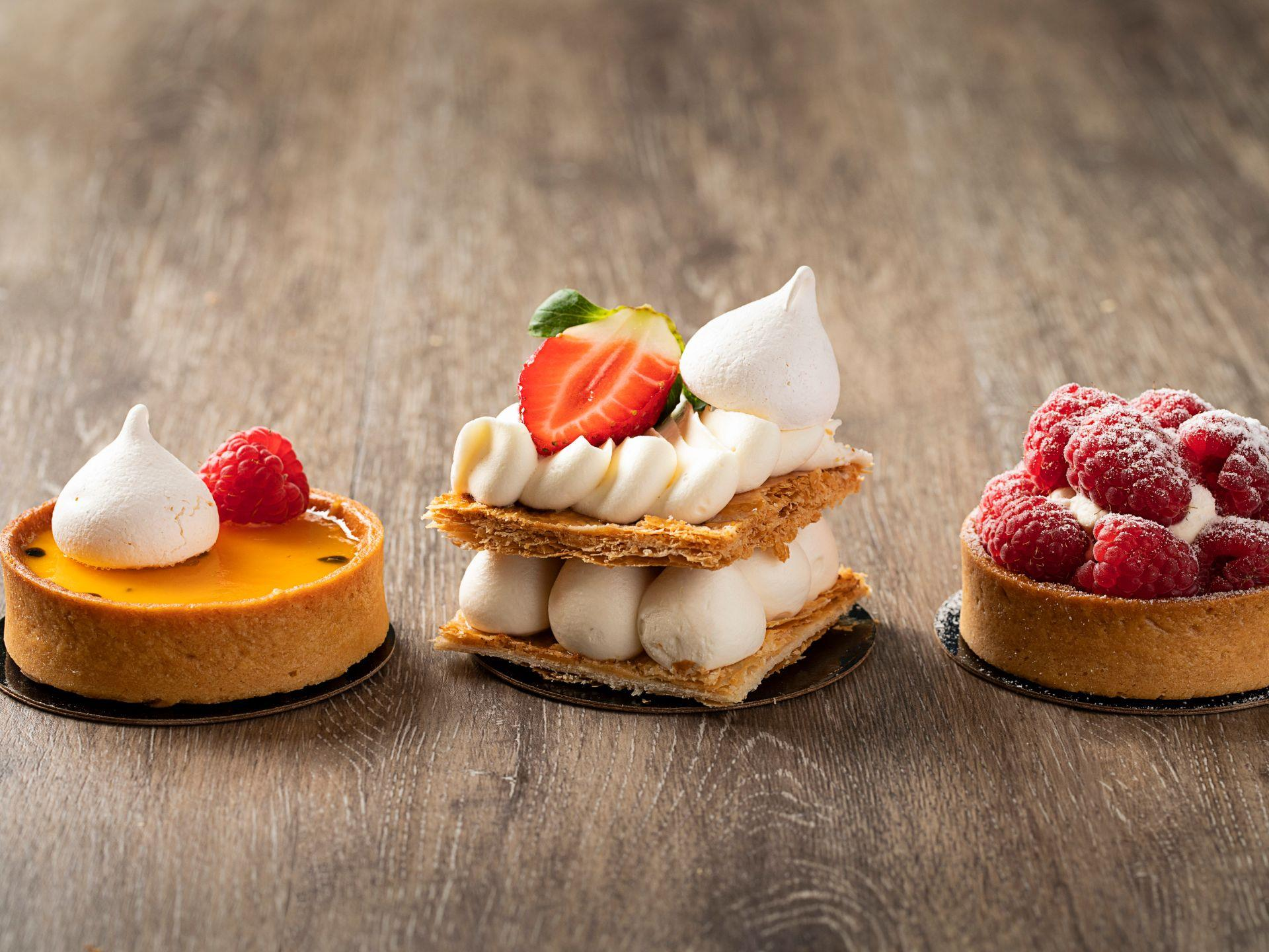 Three assorted pastries arranged on a wood table