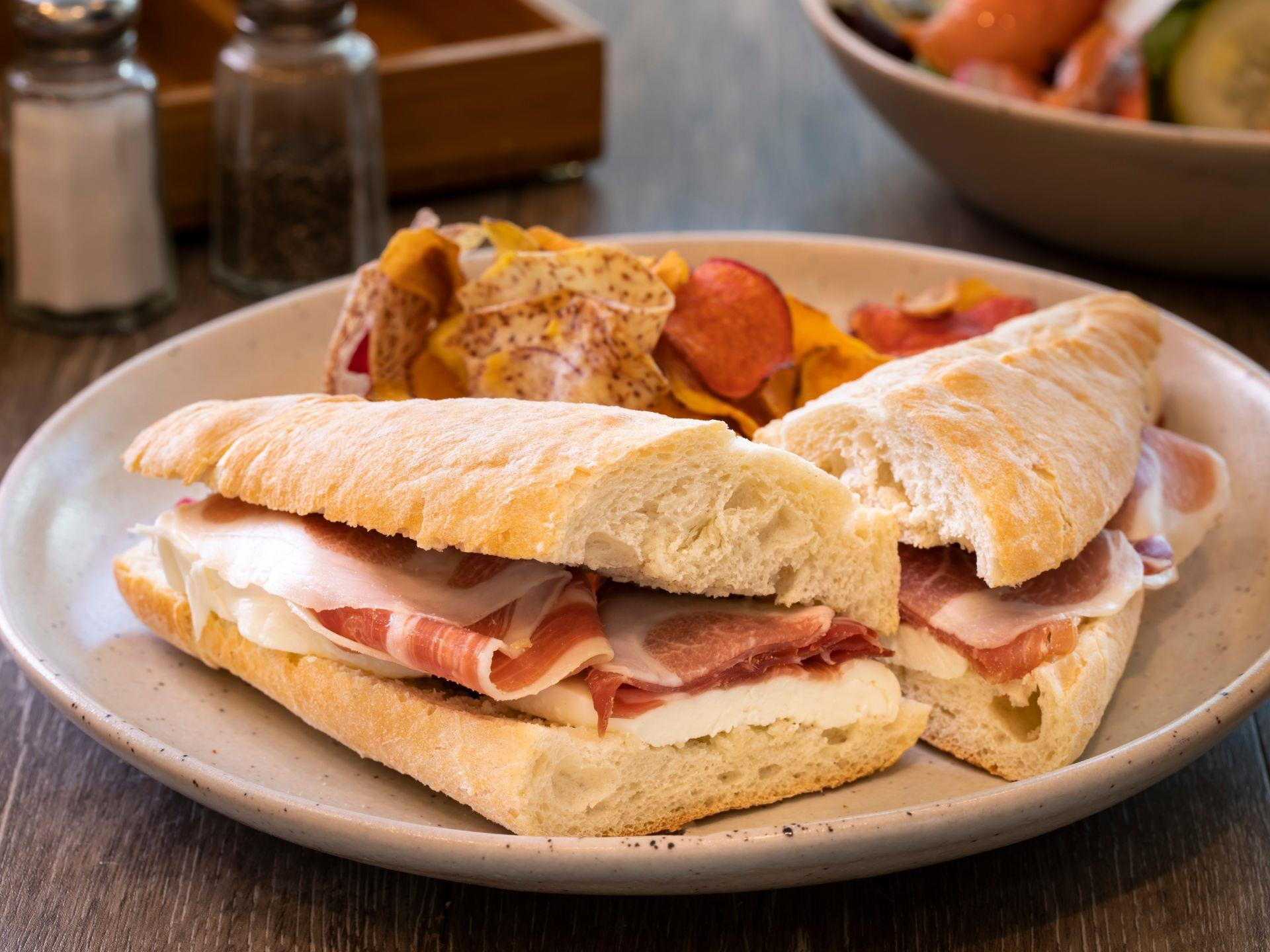 Prosciutto sandwich with mozzarella on a baguette