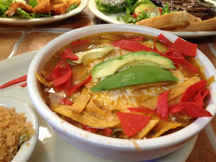 close-up of soup in a bowl with tortilla chips