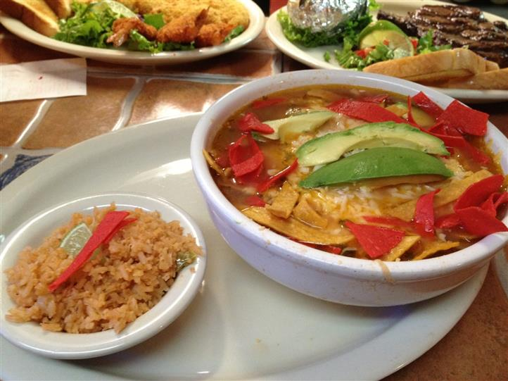 soup in a bowl with tortilla chips