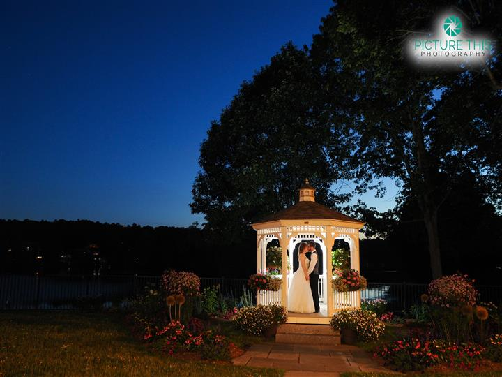couple kissing in the outdoor gazebo during the night